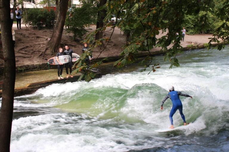Surfer in Blue Wetsuit in English Garden Munich